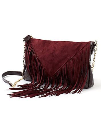 Embrace your free-spirited side with this boho-chic handbag. Featuring a faux croc body and faux suede fringe, this striking piece is sure to stand out in your accessories wardrobe. A long, chainlink strap completes the look. Zip top. One inside zip pocket. catherines.com