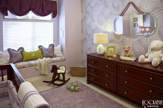 Gorgeous wallpaper in this purple nursery! #nursery