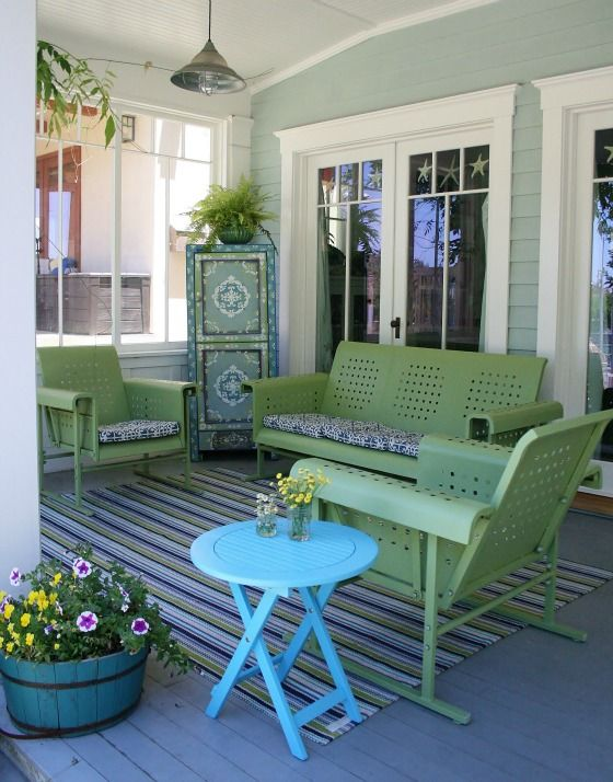 Front Porch: love the painted whiskey 1/2 barrel - from the glamorous housewife.com