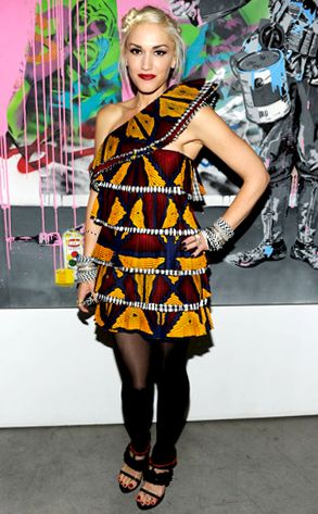 The fashionista rocks a tribal-print tiered frock and serious arm bling at Spring 2011 Fashion Week.
