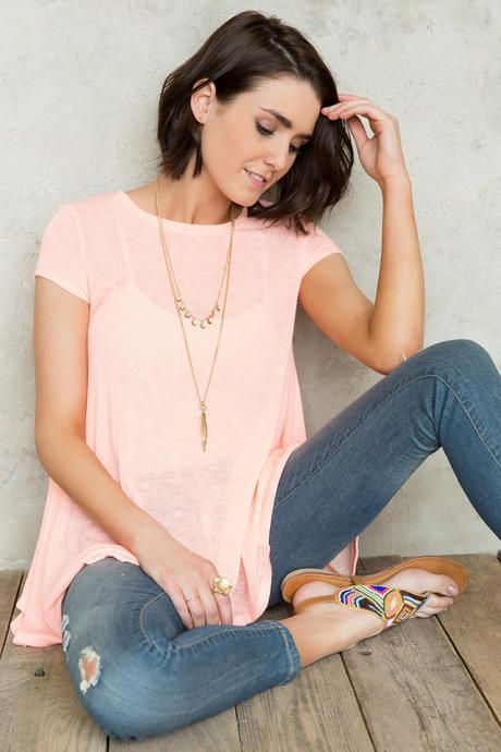 This neon tee is the perfect choice for a day of sightseeing! This breezy tented tee boasts a bold neon coral color. Style over a pair of white denim with some strappy sandals for a casual yet chic outfit!: