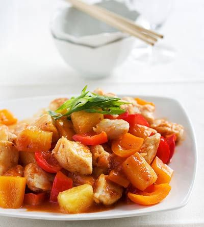 Chinese-style sweet and sour chicken, stir-fried with bell peppers and pineapple chunks.