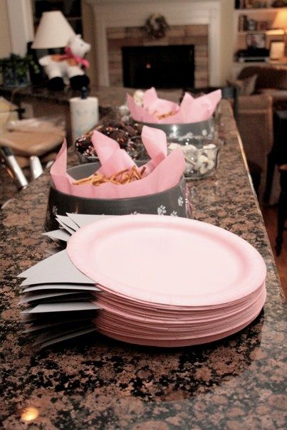 paper plate idea. saves plates because no one walks off with two, guest time because they don't have to eel them apart, and mass frustration from everyone else