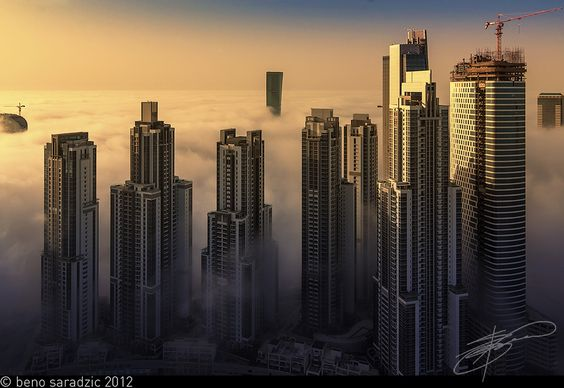 Dubai's Business Bay under the veil of morning fog. I took this shot with Canon TS-E 17mm tilt/shift lens on a 5D Mk 2. There was a golden warmth coming off the early morning sun which was further enhanced in post.