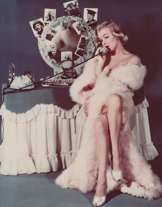 Marilyn Monroe in a feather robe at a retro vanity