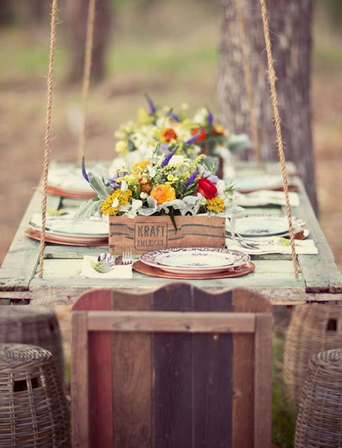 Love the door being hung from a tree to make a table!