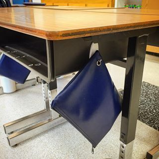 Stick Command hooks to the sides of desks and use them to hang supplies. | 35 Cheap And Ingenious Ways To Have The Best Classroom Ever