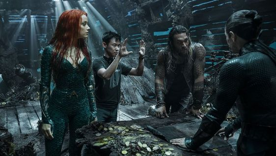 James Wan with Jason Momoa and Amber Heard on the sets of Aquaman