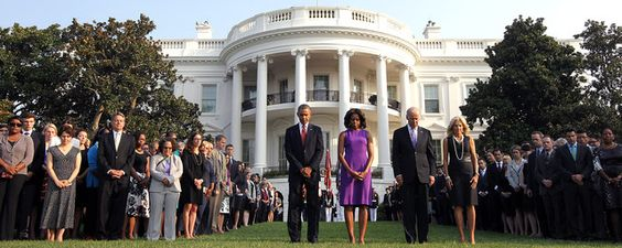 On the 12th anniversary of the 9/11 attacks, Americans paused Wednesday to honor and reflect on the events of that day, even as the nation barely stepped back from the brink of military strikes against Syria.  President Barack Obama stood in a mome