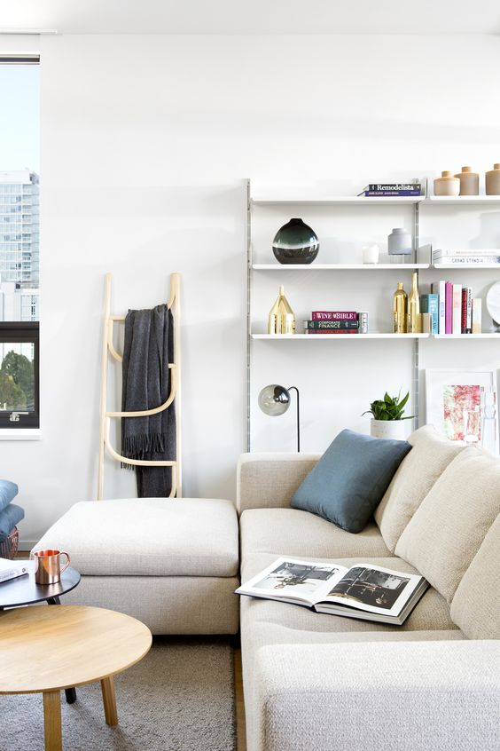 Interior Design by Falken Reynolds - Vancouver Loft apparent sitting room with mid century modern Vitsoe shelving, Hay tables, Roll & Hill and Gubi lighting, bespoke sofa, Bend Goods basket, Eames Lounge Chair, Jeff Martin Joinery coastal credenza, accessories from Provide Home & Inform Interiors. Photo: Ema Peter