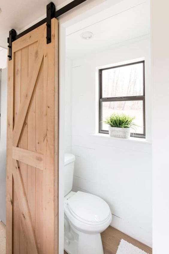 Barn doors or pocket doors  [5 Brilliant Small Space Solutions Inspired by Tiny Homes | Apartment Therapy]