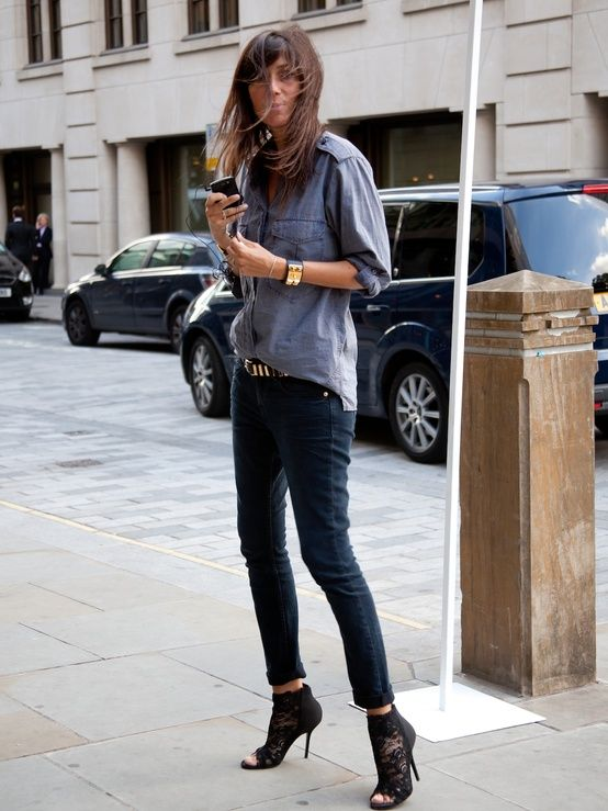 The epitome of Parisian chic. Lessons to learn from style icon  Emmanuelle Alt. Her only accessories: gold hardware and black leather belt and cuff. Did we forget to mention those killer black lace peep-toe booties?