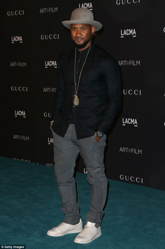 Man of style! Usher stepped out in style in a fashionable hat, comfortable trousers and slick cream white sneakers
