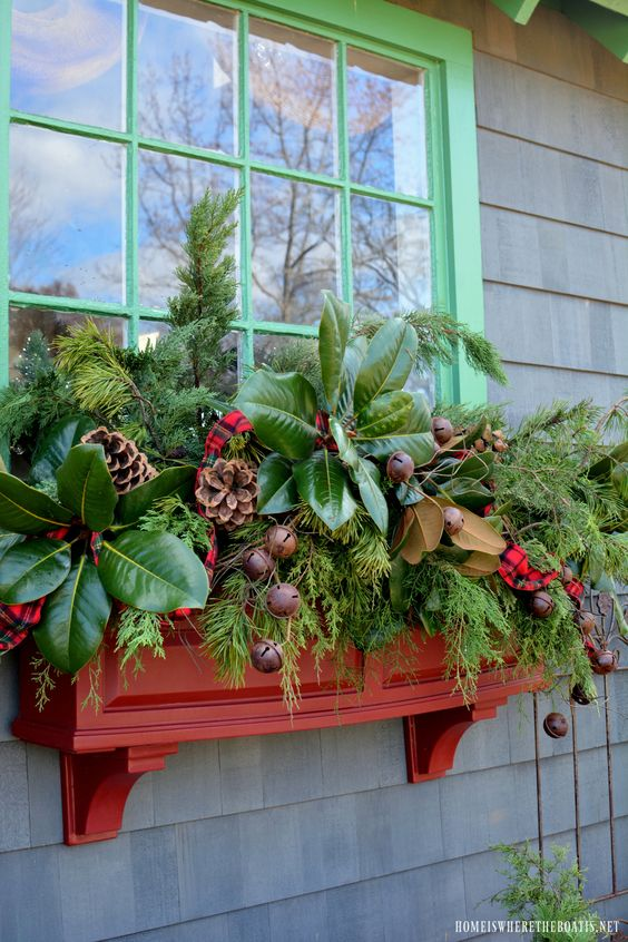 window winter container dcorated with checkered fabric and bells #christmas  #containers #planters #gardenplanters #pinecones
