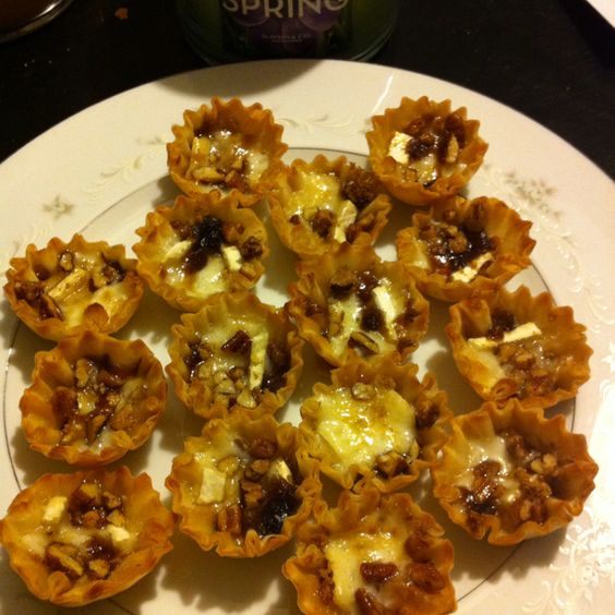 Baked Brie in phyllo tarts with brown sugar and honey. Bake until the Brie melts. So easy and so good!