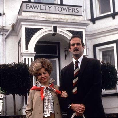 Fawlty Towers. [Pictured, actors Prunella Scales & John Cleese] If you don't laugh @ anything else, try this BBC series. J. Cleese is at his best! He plays an Inn Keeper who basically loathes humanity, especially his unique/quirky staff and, of course, the guests!  :) PH