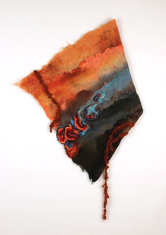 handmade felt wall piece made of dyed, unspun wool and yarns, by Sharron Parker. It has references to heat and embers floating over a smoky landscape.