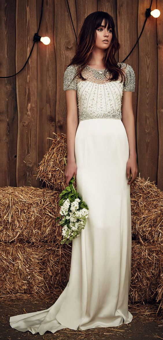Jenny Packham Spring 2017 white silk Carrie wedding dress with crystal-embellished bodice and short sleeves and illusion neckline with central pearl accent