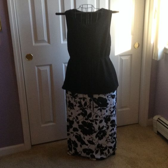 One piece maxi dress One piece, looks like maxi skirt and blouse. Black waffle material on top, black and white floral bottom. Never worn Dresses Maxi