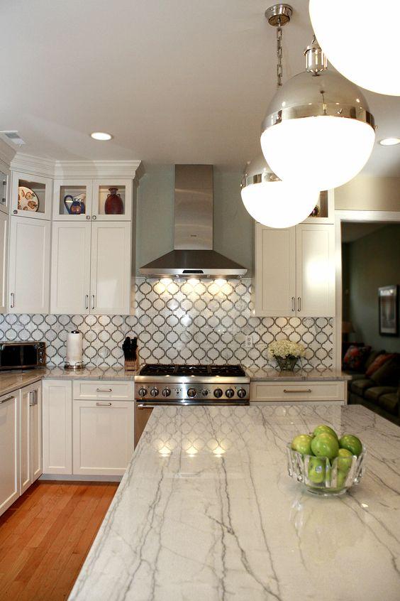 White Macaubas Quartzite Countertops & Calacatta Gold backsplash tile. Kitchen by Stoneshop from Cherry Hill, NJ.