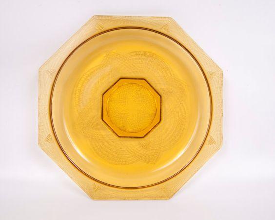 He encontrado este interesante anuncio de Etsy en https://www.etsy.com/es/listing/216033286/vintage-l-e-smith-romanesque-amber