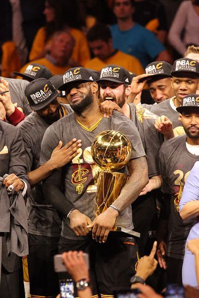 LeBron James of the Cleveland Cavaliers holds up the Larry O'Brien Trophy after the 2016 NBA Finals Game Seven against the Golden State Warriors on...