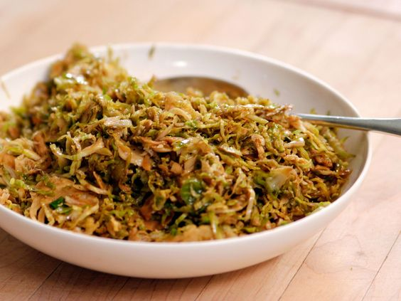 """Sauteed Shredded Brussels Sprouts : """"There's so much going on in the oven on Thanksgiving, even if you're smoking a turkey, that it's really nice to have a vegetable that you can cook on top of the stove,"""" Ina says of her Brussels sprouts. To save additional time, slice them the day before and refrigerate in a plastic bag."""