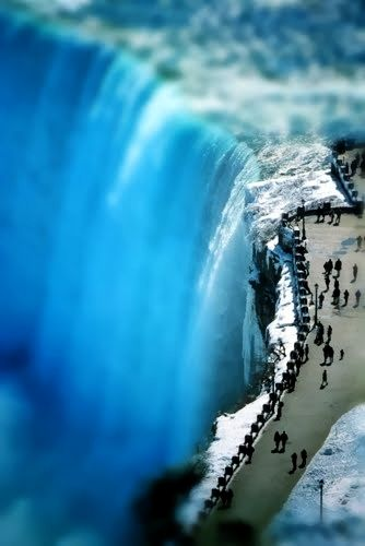 Niagara Falls in Winter. I have been there in the winter. It is like walking into a winter scene of a frosted Christmas card. BEAUTIFUL.