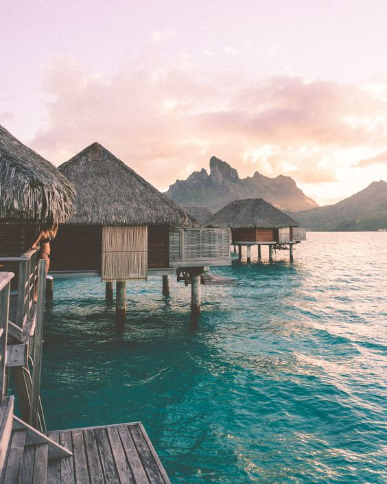 Sunset from our overwater bungalow at Four Seasons Bora Bora for our honeymoon via @finduslost