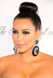 This is EXACTLY how I want my hair for the wedding. But I do want to add rhinestones for some bling! Kim Kardashian with a donut hair bun #hair