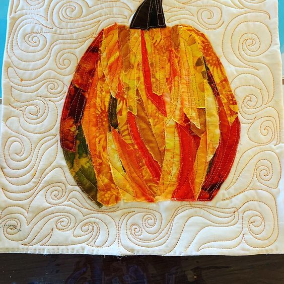 A quick improve artsy pumpkin. I cut several strips of fabric from about 6 different fabrics and just started sewing them onto the top. Till it made a shape I liked.