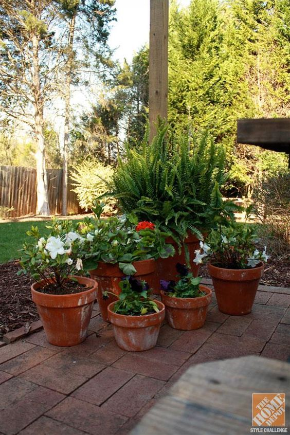 A classic brick patio makeover by bryn of bryn alexandra for Outdoor decorating with potted plants