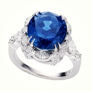 Lost in the deep abyss of this stunning 8 carat blue sapphire, elegantly set with 2 carats of marquise and round brilliant cut diamonds. #EdwardElise
