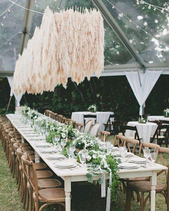 We're obsessed with pampas grass, and we're telling you all about it over on the blog today. (Though this pic alone might show you why we're so smitten!) Hit the link in the bio to get gorgeous ideas for using this versatile (and cost effective!) foliage for your big day.  Photo by @natalienorton // Design by @floral_inspirations // Rentals @signaturemaui  #wedding #inspiration #decor #stylish #chic #pampasgrass #uniqueideas #uniquewedding #bmloves #linkinbio #bridalmusings