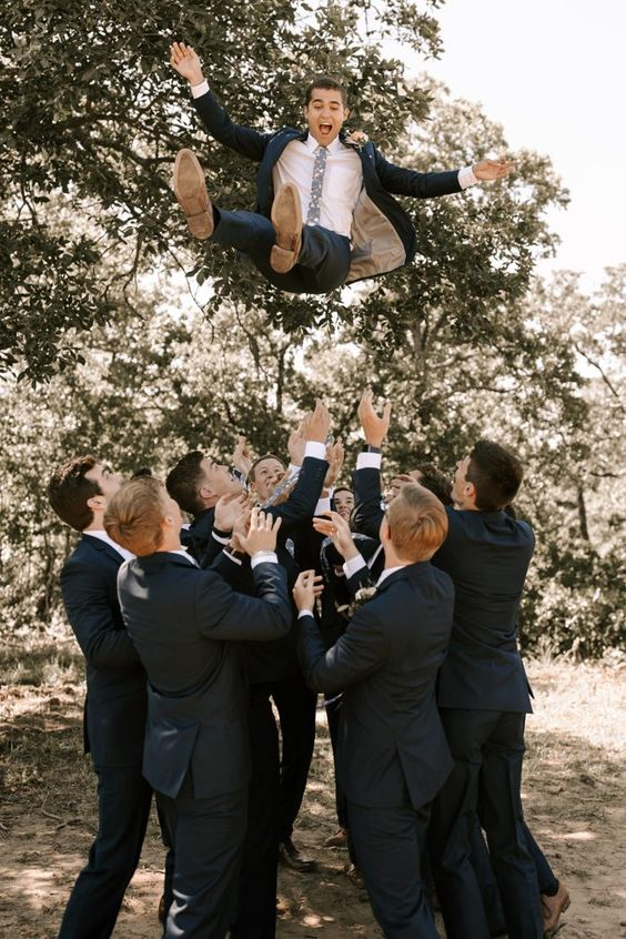 Cute moment as the groomsmen throw the groom into the air | Image by Patricia P Photography