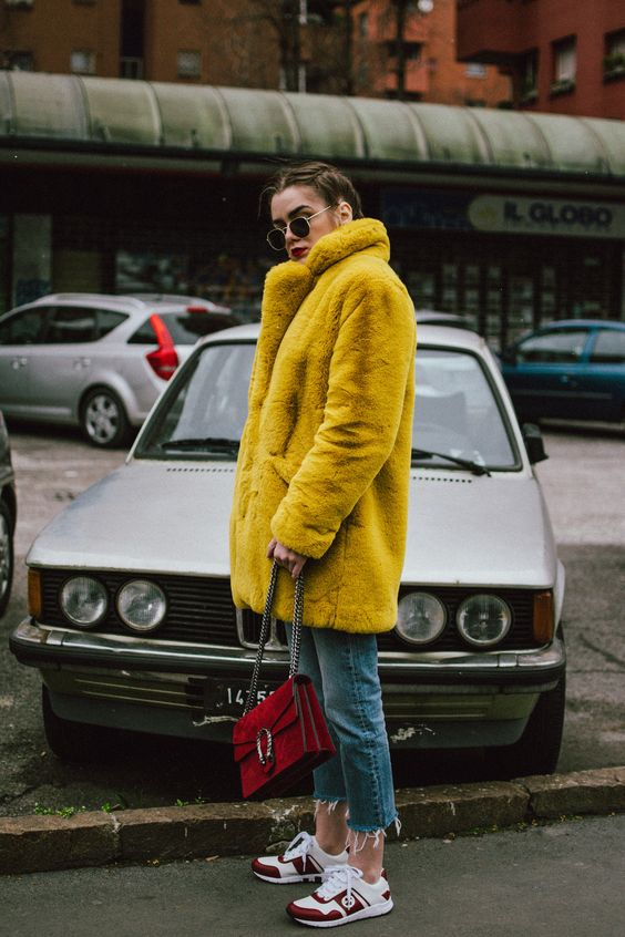Boohoo yellow faux fur coat, double denim levi's jeans, gucci sneakers, gucci bag, milan, cute winter outfit 2018, andreea birsan, couturezilla, cropped raw hem levi's jeans, raw hem star printed cropped denim jacket, red cashmere sweater, t-shirt, ray ban hexagonal sunglasses, gucci red suede dionysus bag, gucci white and red sneakers, how to wear sneakers in winter, how to wear double denim like a pro, colorful coat, teddy bear coat in yellow, corn braids, heart shaped earrings, how to dress i