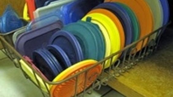 Use a Disk Rack to Organize Tupperware and Pot Lids