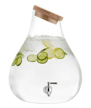 Go modern with an elegantly slanted glass jug that is corked with a natural wood stopper.