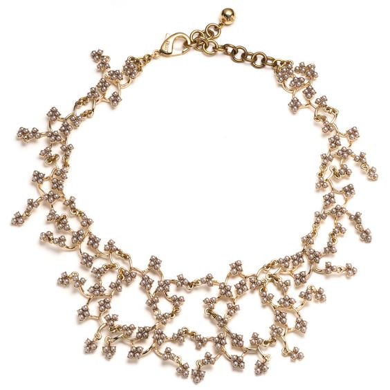 "One of our team favorites, this lace-like necklace is inspired by the classic style of Jackie O. The piece is hand-crafted of gold-plated brass and glass pearl elements delicately woven together in a net of gorgeousness.  Antique gold-plated brass, raw brass, glass pearls Measures 15""l with 2.5"" chain extension"