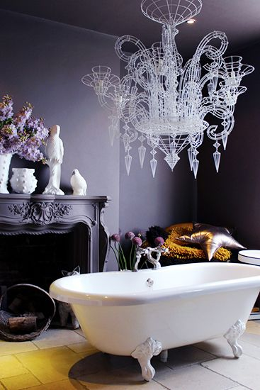A chandelier and a claw foot tub make one magical bathroom // Statement Bathrooms: