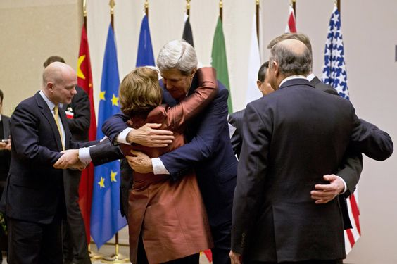 IN AGREEMENT: U.S. Secretary of State John Kerry, center, embraced EU foreign policy chief Catherine Ashton during a ceremony at the United ...