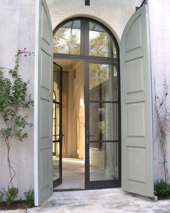 Arch top steel frame glass doors with paneled wood stormsecurity