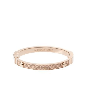 Stack your arm with standout sparklers like our cult-favorite Astor bracelet. Perfectly embellished with the prettiest pavé detail, this rose gold-tone piece will be a dazzling addition to a wrist full of mix-and-match metallics. Wear it to add an instant dose of glamour to any outfit, piling it up with an oversized watch and studded bangle for a rock-chic finish.