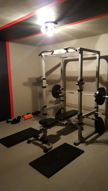 Home gym garage black wall paints and beast mode on