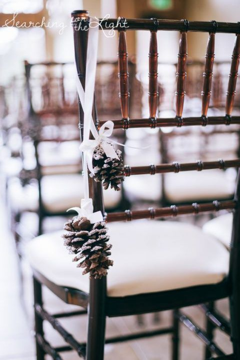 25 Ways To Incorporate Pinecones Into Your Wedding Pinecone Wedding Decorations Wedding Chair Decorations Wedding Ceremony Chairs