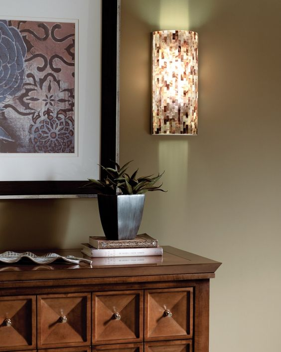 Love the wall sconce.