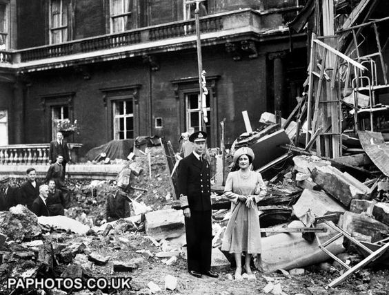 """The King and Queen stand amid the bomb damage at Buckingham Palace during WWII. The Palace was a deliberate target for the Luftwaffe as their High Command felt that the destruction of the Royal Palace would demoralize the nation.  But it had the opposite effect and the Queen was famously to utter """"I'm glad we have been bombed. Now I can look the East End in the face."""""""