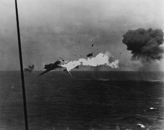 """A Japanese """"Jill"""" torpedo bomber catches on fire and disintegrates after taking fire from USS Yorktown (CV-10) during the Gilbert Islands Campaign. December 4 1943. [3600 x 2858]"""