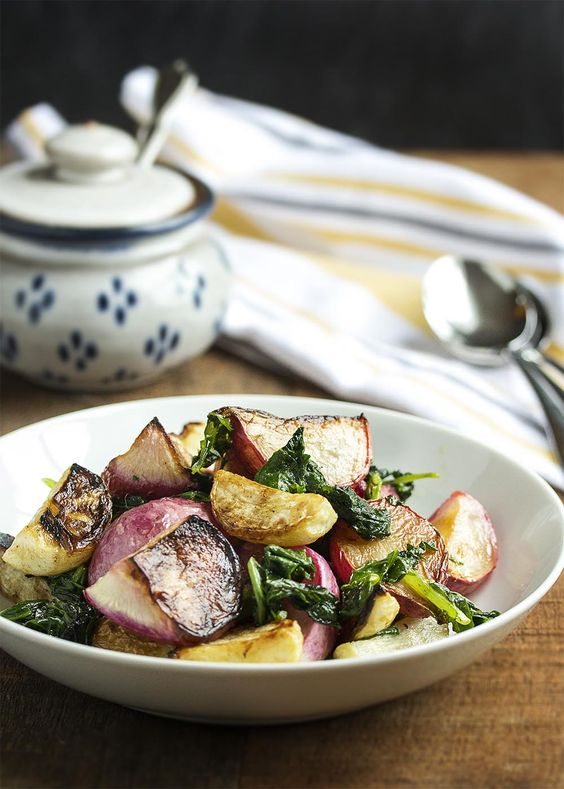 Roasted Turnips and Radishes - Sweet Hakurei turnips and young radishes are tossed with olive oil and roasted with their greens in this simple and satisfying side dish. | justalittlebitofbacon.com: