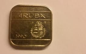 Aruba's famed square coin...50 cents. In the past we had 5 cents square coin and a 5 florin square coin. We out grew the 5 cent one and the 5 florin one did not stick. Now the 5 florin is a round coin.